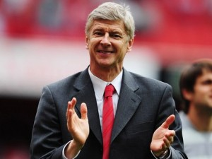 Arsene Wenger applauds his team