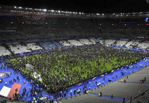 Fans flock onto the pitch after bombings